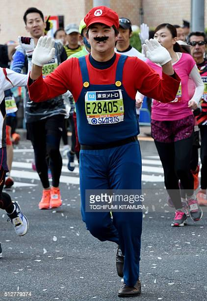 A runner wearing a Super Mario costume competes during the Tokyo Marathon in Tokyo on February 28 2016 AFP PHOTO / TOSHIFUMI KITAMURA / AFP /...