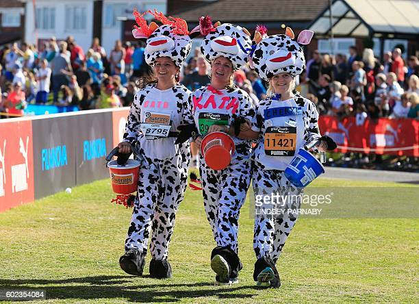Runner wearing fancy dress approach the finish line in the Great North Run halfmarathon in South Shields north east England on September 11 2016 The...