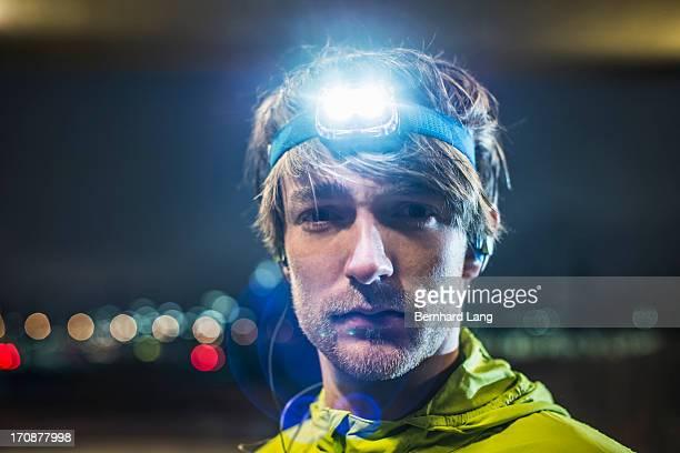 Runner wearing head torch, close up