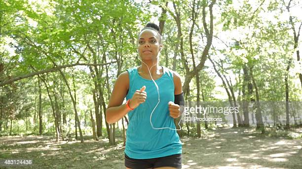 Runner wearing mp3 player in armband, listening to headphones