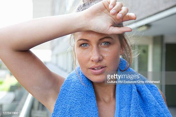 Runner wiping sweat from brow