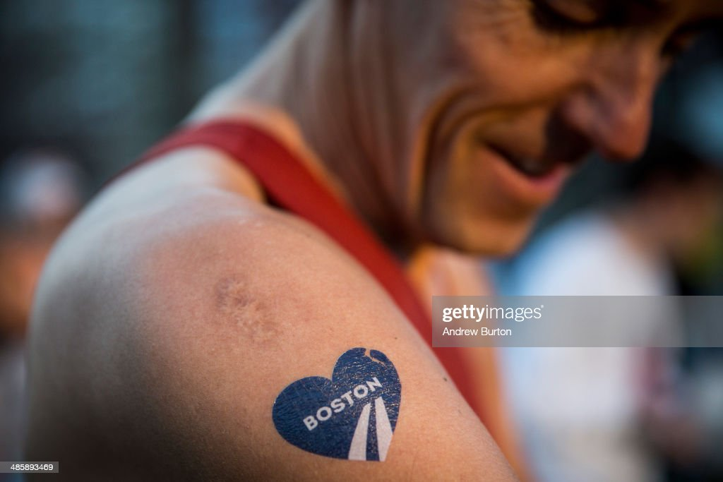 A runner with a temporary Boston Marathon tattoo gets ready to run the 118th Boston Marathon in the Boston Commons on April 21, 2014 in Boston, Massachusetts. Today marks the 118th Boston Marathon; security presence has been increased this year, due to two bombs that were detonated at the finish line last year, killing three people and injuring more than 260 others.