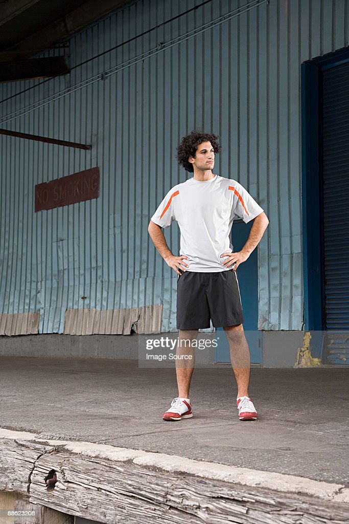 Runner with hands on hips : Stock Photo