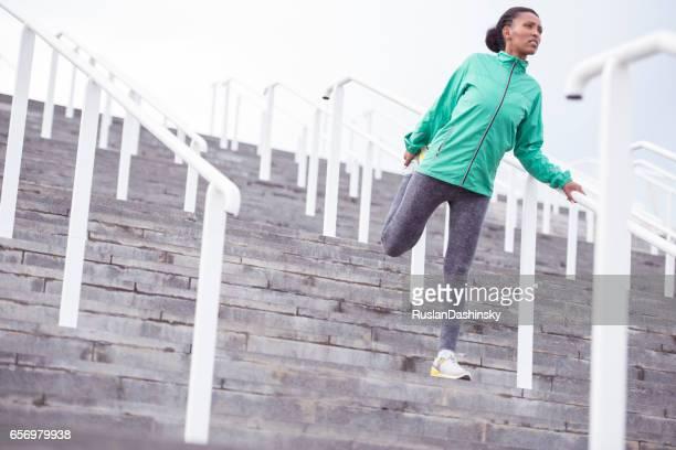 Runner woman stretching exercising.
