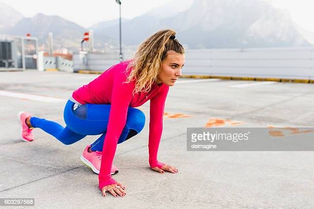 Runner woman stretching outdoor city