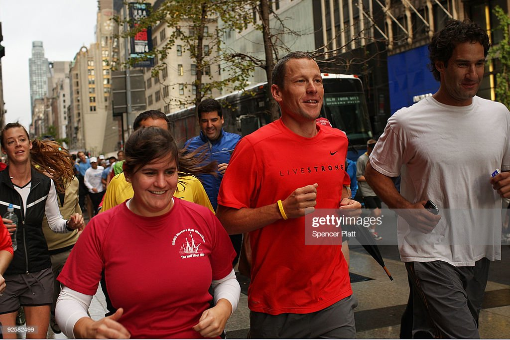 Runners and fans jog with Lance Armstrong in midtown Manhattan for a group run in Central Park on October 31 2009 in New York City Following a...