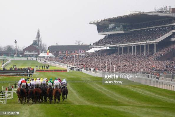 Runners and riders begin the first race The William Hill Supreme Novices' Hurdle during day one of the Cheltenham Festival at Cheltenham Racecourse...