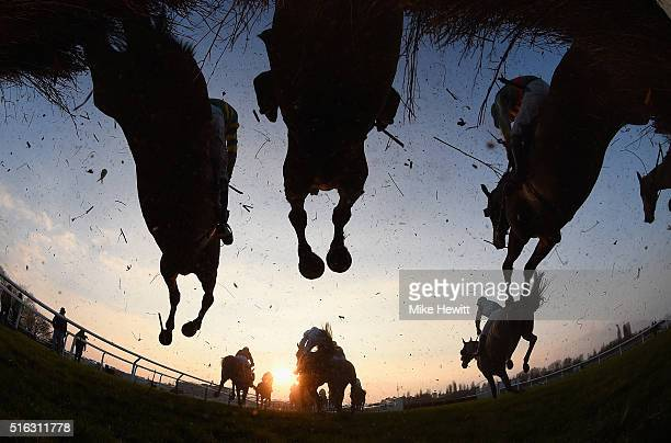 Runners and riders jump the third last during the Fulke Walwyn Kim Muir Challenge Cup Handicap Chase on St Patrick's Thursday at Cheltenham...