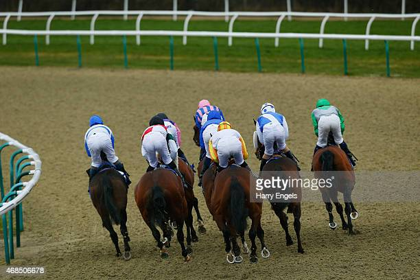 Runners and riders round the first bend during The Coral Easter Classic AllWeather Middle Distance Championships Conditions Stakes at Lingfield...