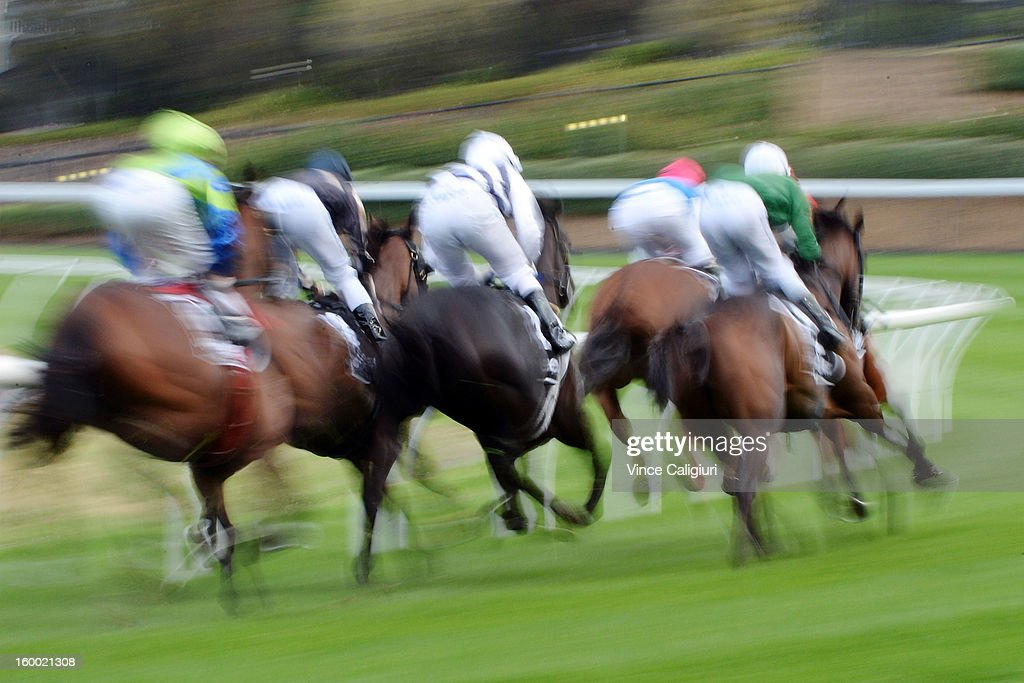 Runners and riders round the home turn with a lap to go in the Aquanas Foods Premium Handicap during Melbourne racing at Moonee Valley Racecourse on January 25, 2013 in Melbourne, Australia.
