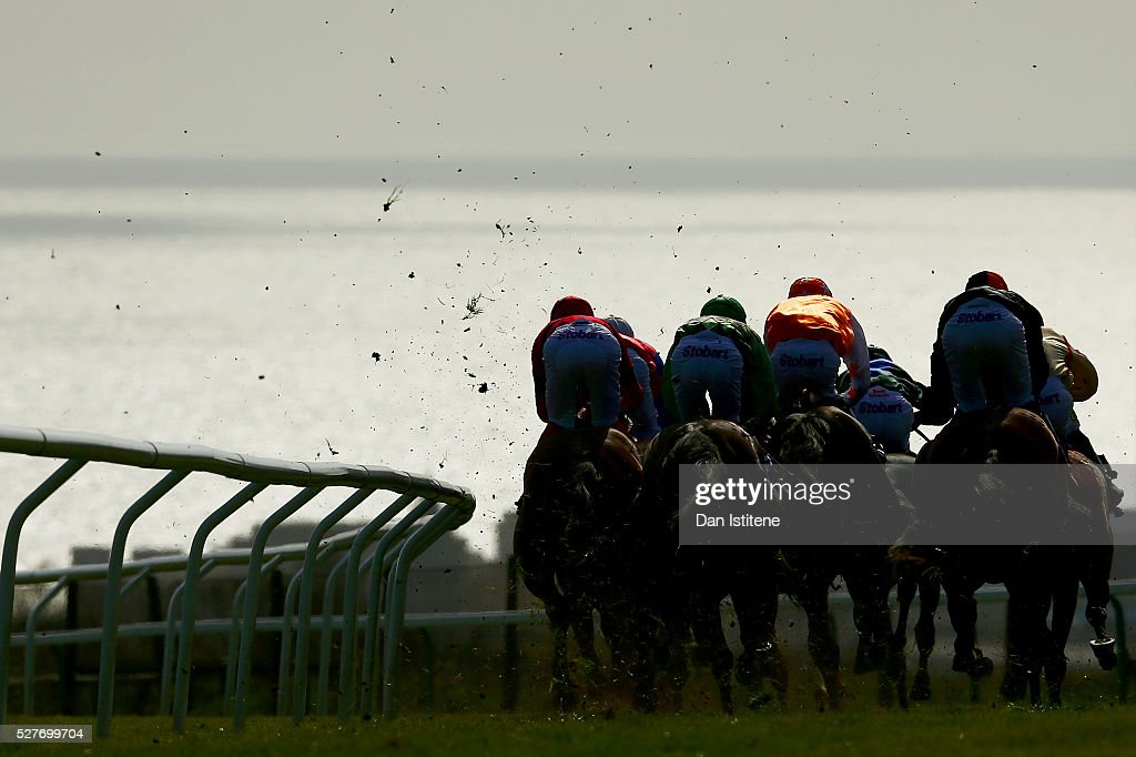 Runners and riders take part in the letsdobusiness.org Brighton 12 May Classified Stakes at Brighton Racecourse on May 3, 2016 in Brighton, England.