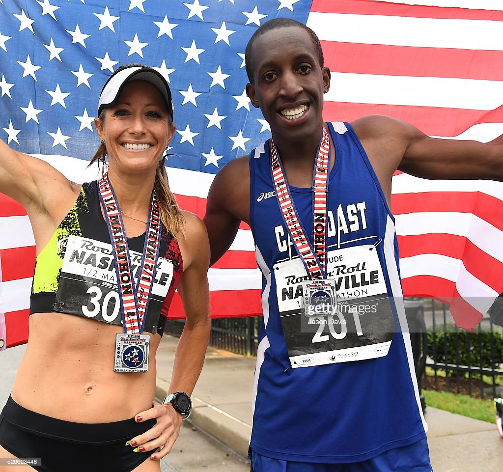Runners and Winners of men's and women's half marathon; Julie Stackhouse and Roosevelt Cook celebrate as they cross the finish-line in the St. Jude Rock 'n' Roll Nashville Marathon/Half Marathon and 5k where more than 34,000 participants weathered the rain during the 17th running on April 30, 2016 in Nashville, Tennessee.