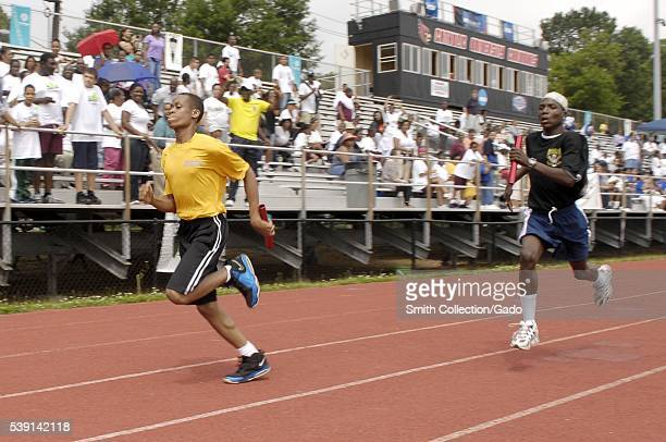 Runners at the 2012 Washington DC Special Olympics represent the US Navy and Army during a 4x100 meter relay race at the 2012 Washington DC Special...