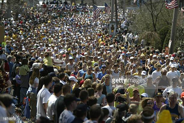 Runners begin the 107th running of the Boston Marathon on April 21 2003 in Hopkinton Massachusetts