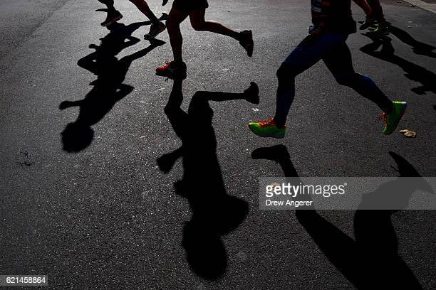 Runners cast shadows as they make their way east on Lafayette Avenue during the 2016 TCS New York City Marathon November 6 2016 in the Clinton Hill...