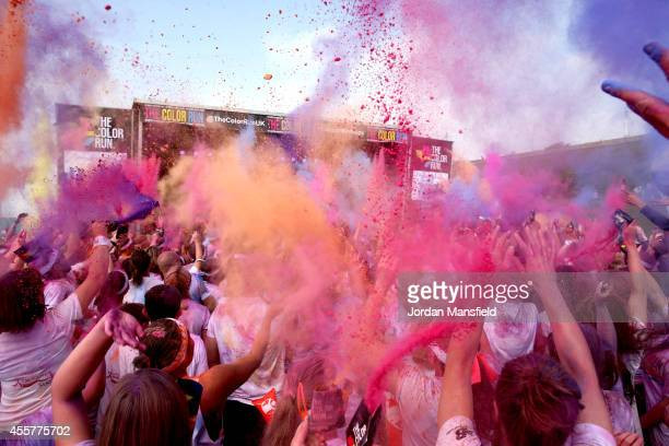 Runners celebrate in the Festival Area after the Color Run presented by Dulux known as the happiest 5km on the planet on September 20 2014 in...
