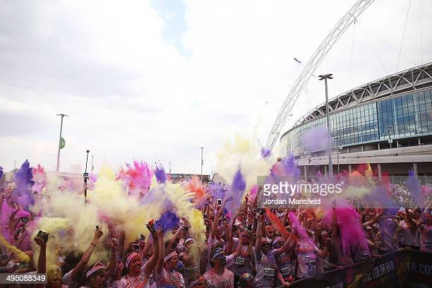 Runners celebrate in the Festival Area after the Color Run presented by Dulux known as the happiest 5km on the planet on June 1 2014 in London...