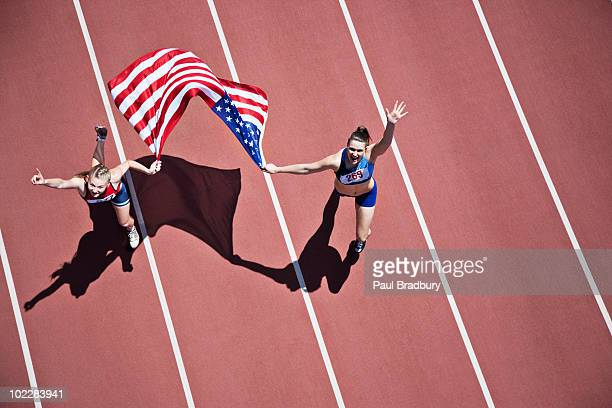 Runners celebrating on track with American flag