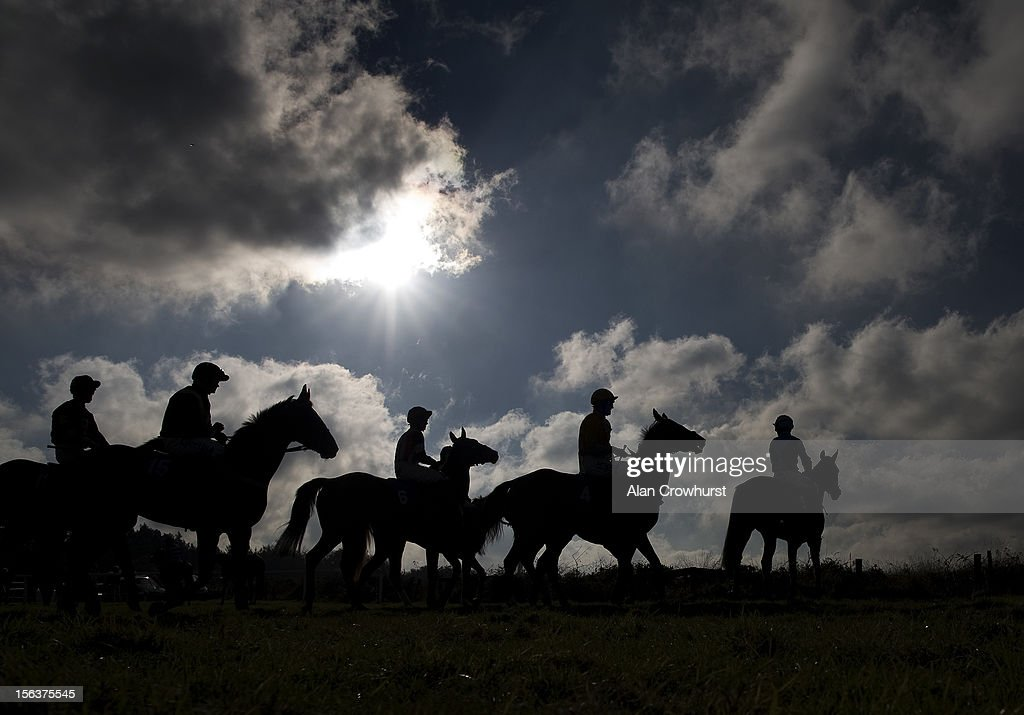 Runners circle at the start of The Aggregate Industries Stoneycombe Novices' Hurdle Race at Exeter racecourse on November 14, 2012 in Exeter, England.