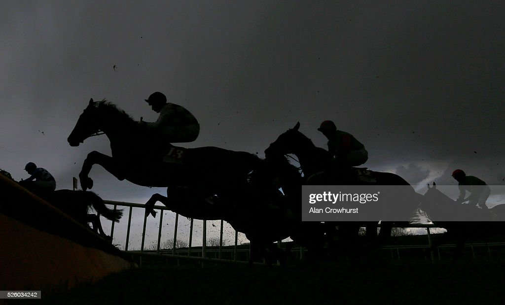 Runners clear a fence at Punchestown racecourse on April 29, 2016 in Naas, Ireland.