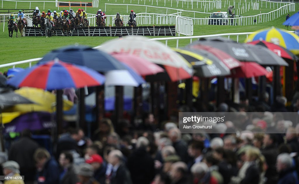 Runners clear the first flight of hurdles in The Colm Murray Memorial Handicap Hurdle at Punchestown racecourse on May 01, 2014 in Naas, Ireland.