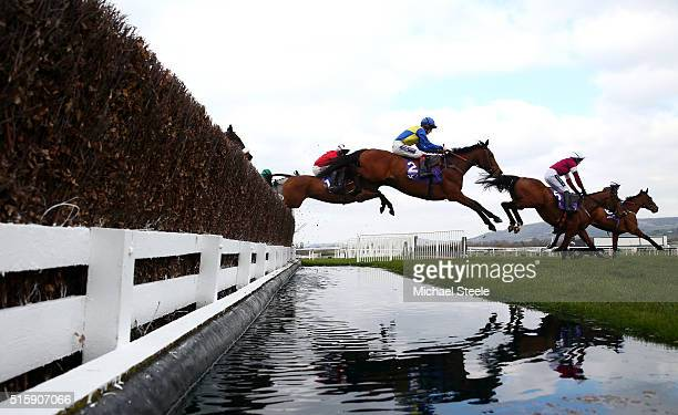 Runners clear the water jump in the RSA Chase on Ladies Day of the Cheltenham Festival at Cheltenham Racecourse on March 16 2016 in Cheltenham England