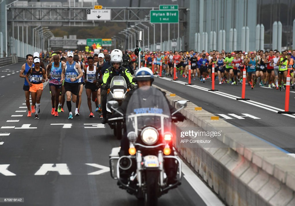 Runners compete during the 2017 TCS New York City Marathon in New York on November 5, 2017. Five days after the worst attack on New York since September 11, 2001, the city is staging a show of defiance on November 5, as 50,000runners from around the world are set to participate in the New York Marathon, under heavy security. /
