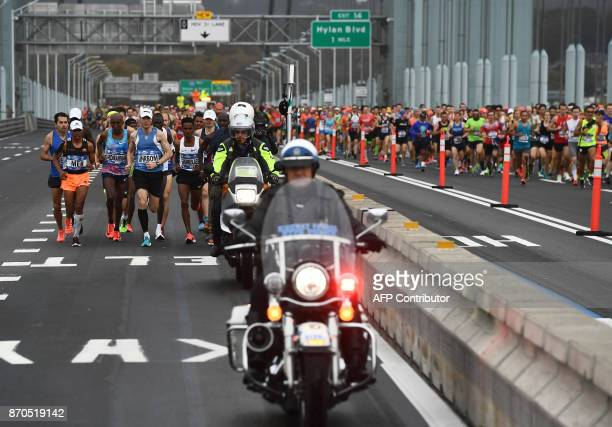 Runners compete during the 2017 TCS New York City Marathon in New York on November 5 2017 Five days after the worst attack on New York since...