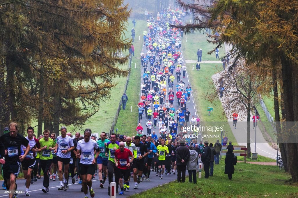 Runners compete during the 30th edition of the Zevenheuvelenloop 15 km running race in Nijmegen on November 17 2013 Kenyan runner Leonard Komon won...