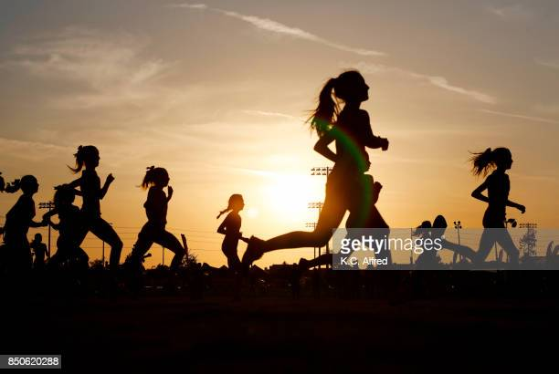 Runners compete in a 5k at sunset in Corona, California.