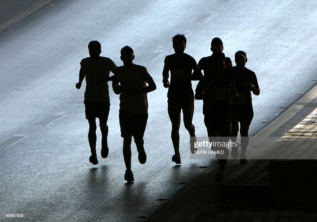 Runners compete in the '3rd International Erbil Marathon' in the northern city of Arbil, capital of Iraq's Kurdistan, on October 25, 2013. The marathon was organised under the motto of 'Let us run for peace and development'.