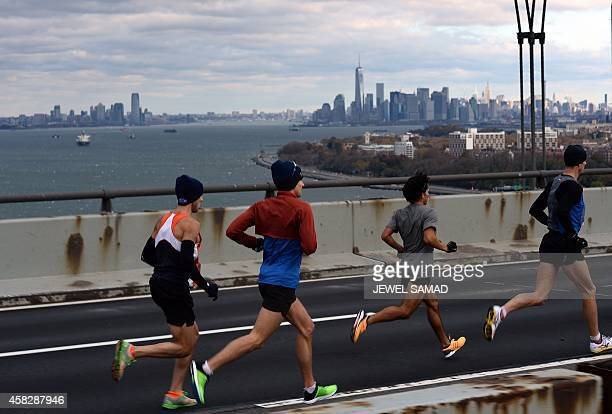 Runners compete in the New York City Marathon on November 2 2014 Kenya's Wilson Kipsang won the New York City Marathon men's title defeating...