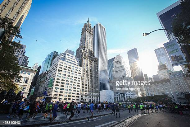 Runners compete in the TCS New York City Marathon through Staten Island Brooklyn Queens Bronx in New York United States on November 2 2014 The...