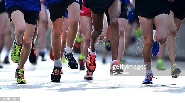 Runners compete in the Virgin Money Giving Mini London Marathon ahead of the Virgin Money London Marathon on April 24 2016 in London England