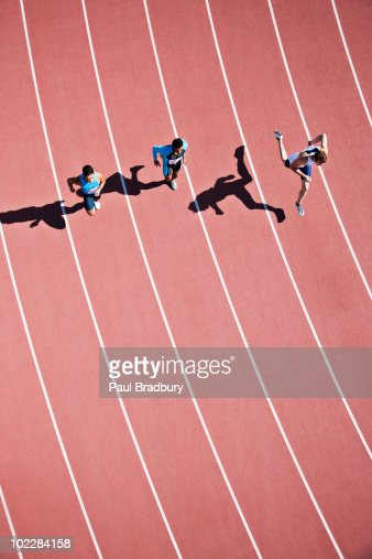Runners competing on track