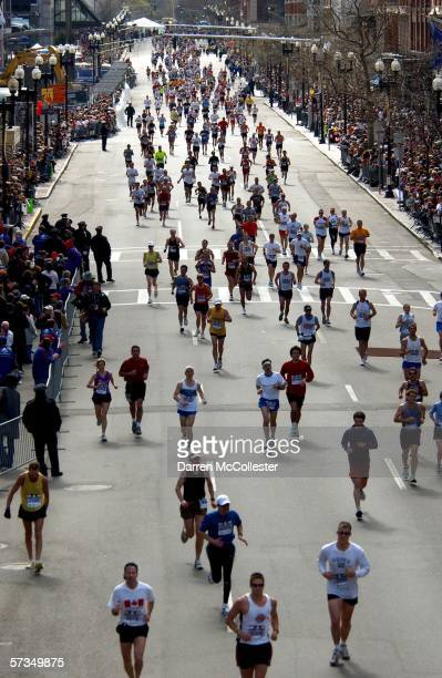 Runners continue to cross the finish line in the 110th Boston Marathon April 17 2006 in Boston Massachusetts Over 22 thousand people have entered to...