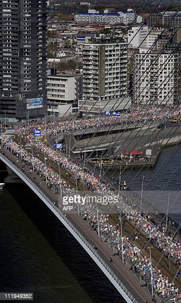 Runners cross the Erasmus Bridge as they compete in the Rotterdam Marathon in Rotterdam on April 10 2011 AFP PHOTO/ANP/GUUS SCHOONEWILLE netherlands...
