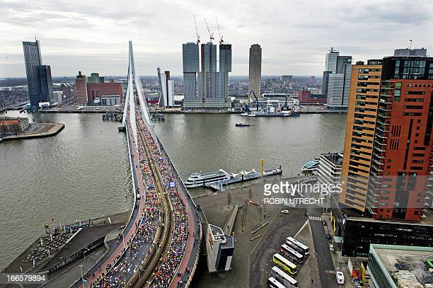 Runners cross the Erasmus Bridge in Rotterdam during the Rotterdam Marathon on April 14 2013 OUT