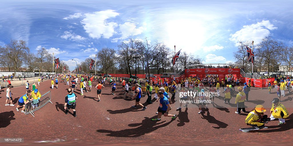 Runners cross the finish line and head to collect their medals during the Virgin London Marathon 2013 on April 21, 2013 in London, England.