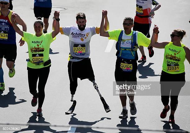 Runners cross the finish line of the 120th Boston Marathon on Monday April 18 2016