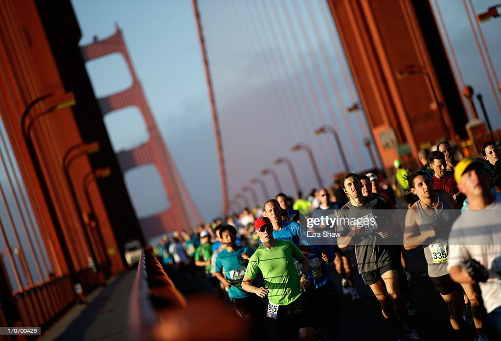 Runners cross the Golden Gate Bridge during the 2013 San Francisco Marathon and Half-Marathon on June 16, 2013 in San Francisco, California.