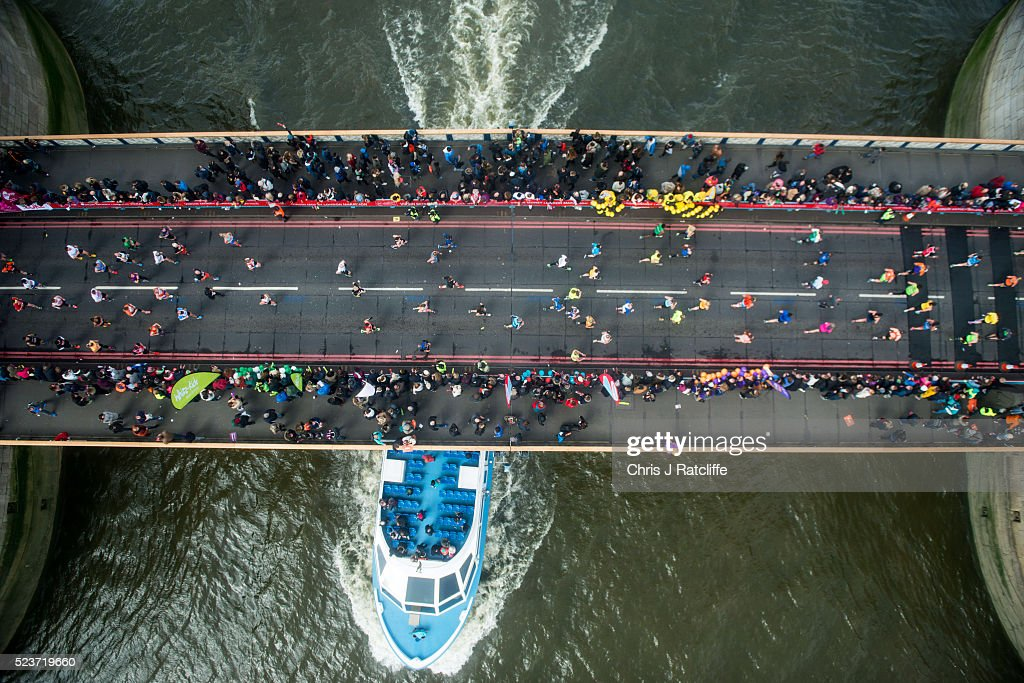 Runners cross the Rive Thames via Tower Bridge during the Virgin London Marathon 2016 on April 24, 2016 in London, England.