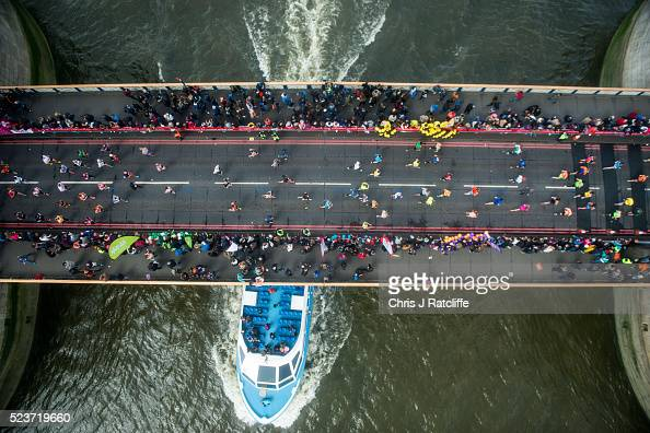Runners cross the Rive Thames via Tower Bridge during the Virgin London Marathon 2016 on April 24 2016 in London England