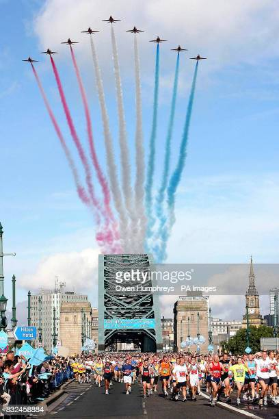 Runners cross the Tyne Bridge as the Red Arrows fly overhead during the Great North Run in Newcastle