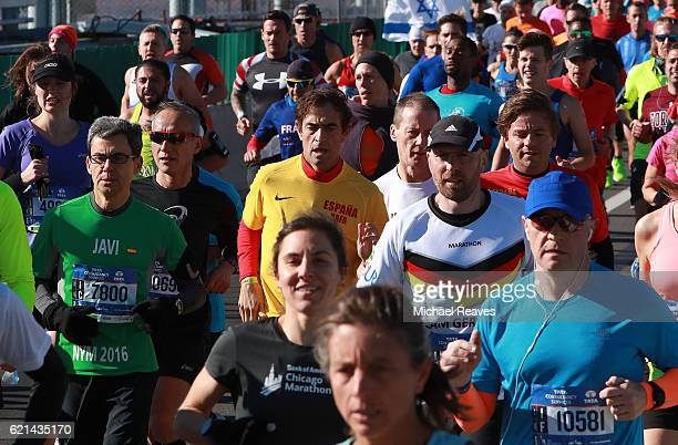 Runners cross the VerrazanoNarrows Bridge at the start of the 2016 TCS New York City Marathon on November 6 2016 in the Brooklyn borough of New York...