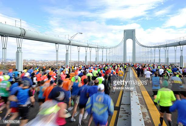 Runners cross the VerrazanoNarrows Bridge at the start of the ING New York City Marathon on November 3 2013 in the Brooklyn borough of New York City