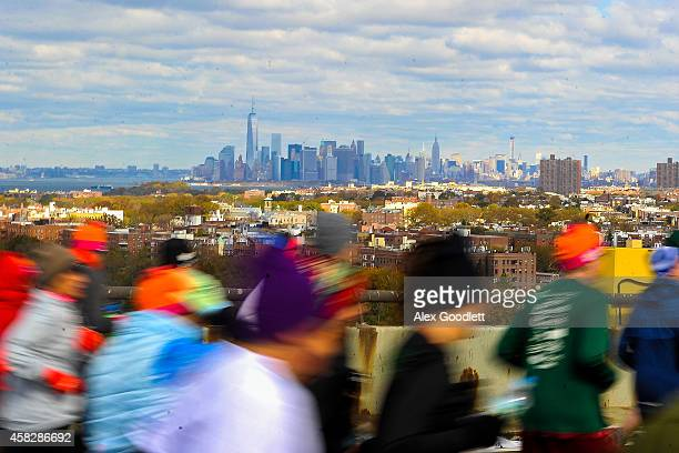 Runners cross the VerrazanoNarrows Bridge at the start of the TCS New York City Marathon on November 2 2014 in the Brooklyn borough of New York City
