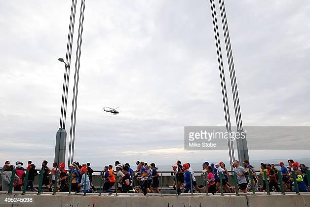 Runners cross the VerrazanoNarrows Bridge at the start of the TCS New York City Marathon on November 1 2015 in New York City