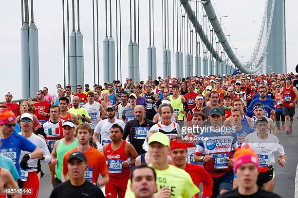 Runners cross the VerrazanoNarrows Bridge at the start of the TCS New York City Marathon on November 1 2015 in New York City