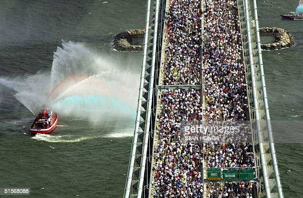 Runners cross the VerrazanoNarrows Bridge from Staten Island into Brooklyn at the start of the 25th Annual New York City Marathon 05 November as a...